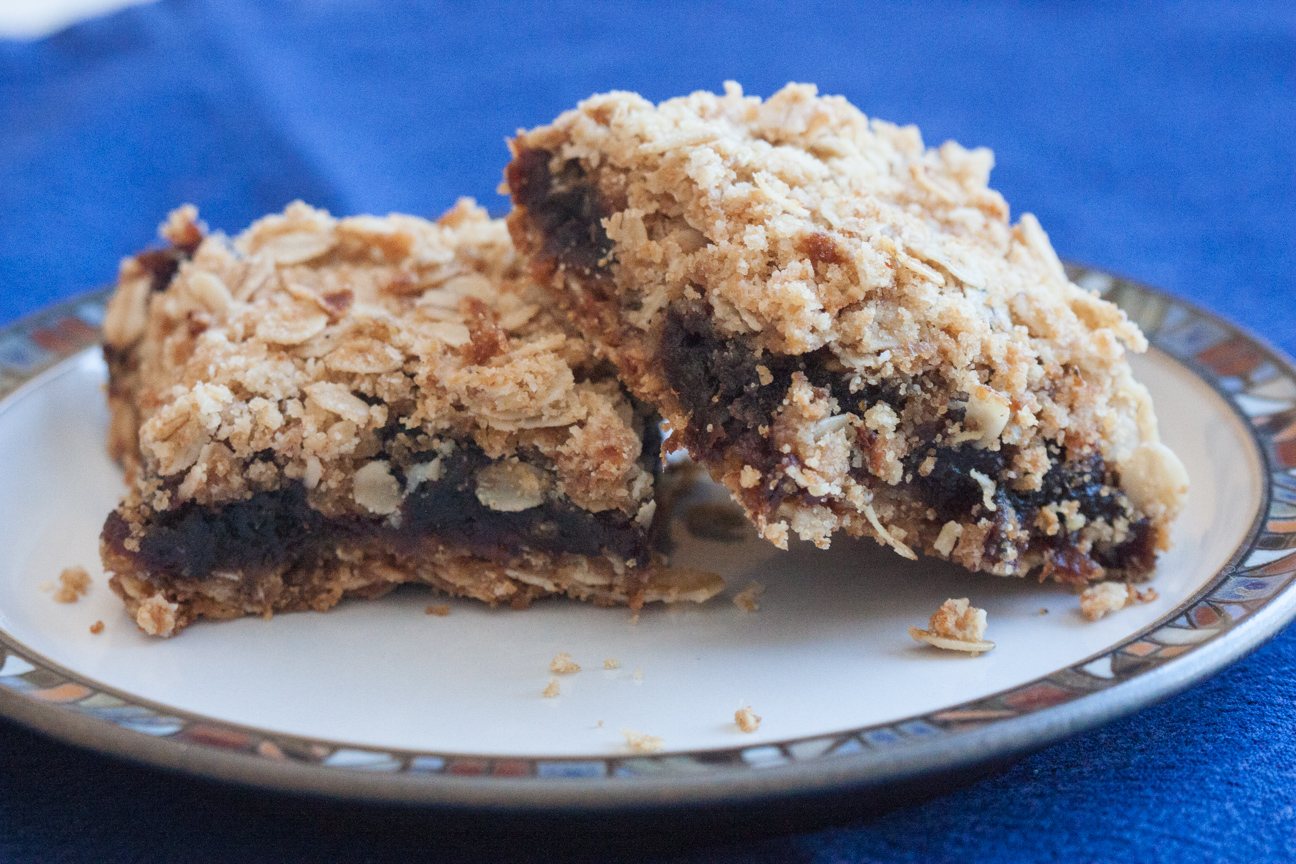 2 pieces of date squares on a plate