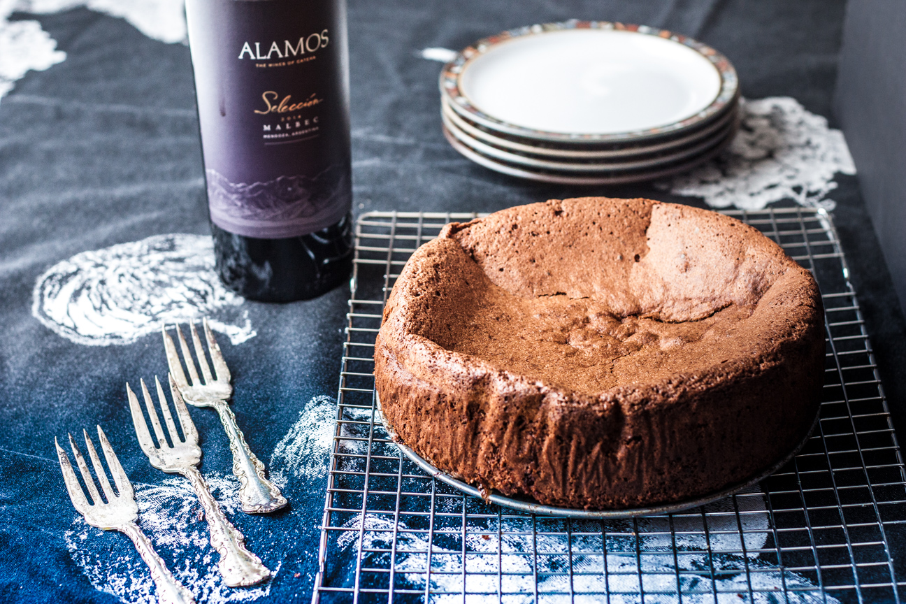 whole chocolate, ginger and hazelnut torte with wine bottle