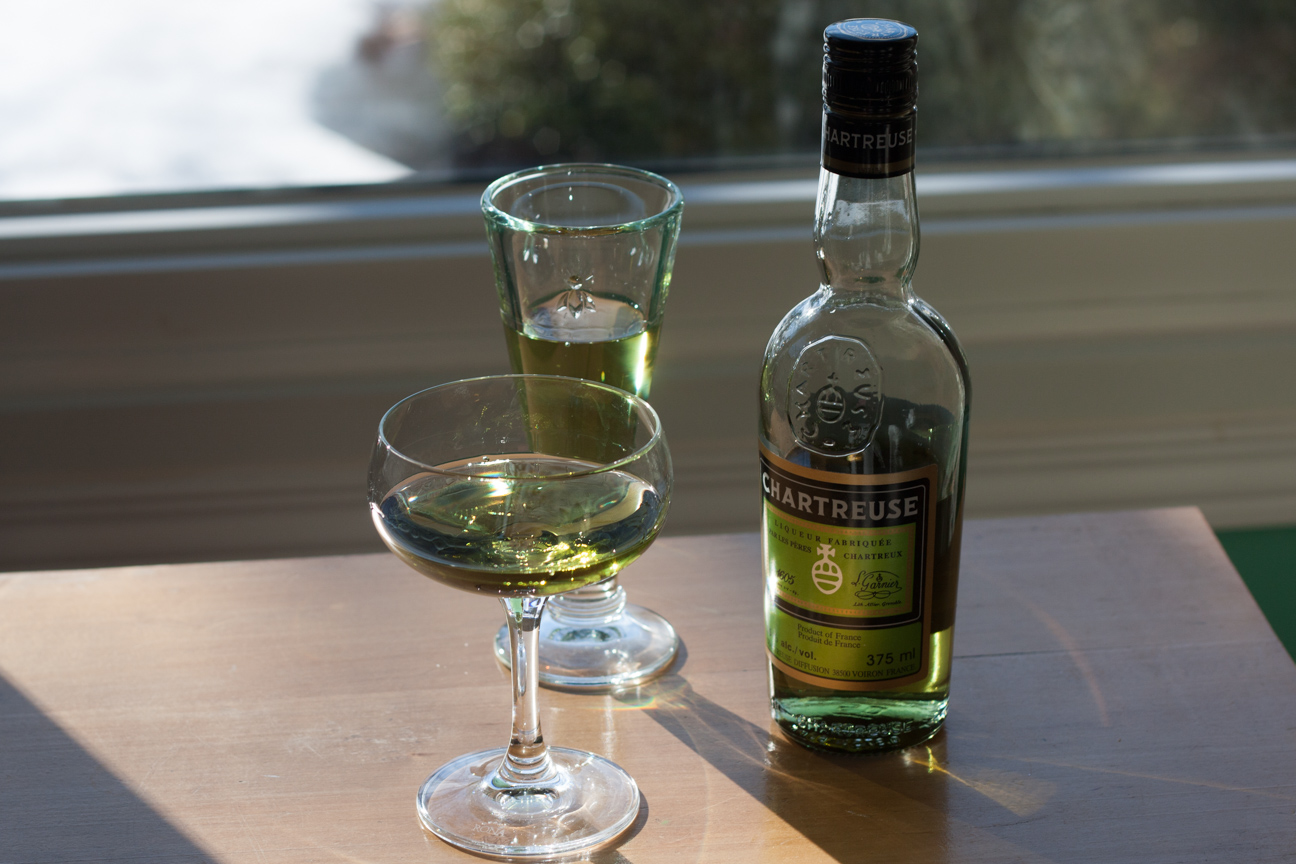 two glasses of Chartreuse and one bottle