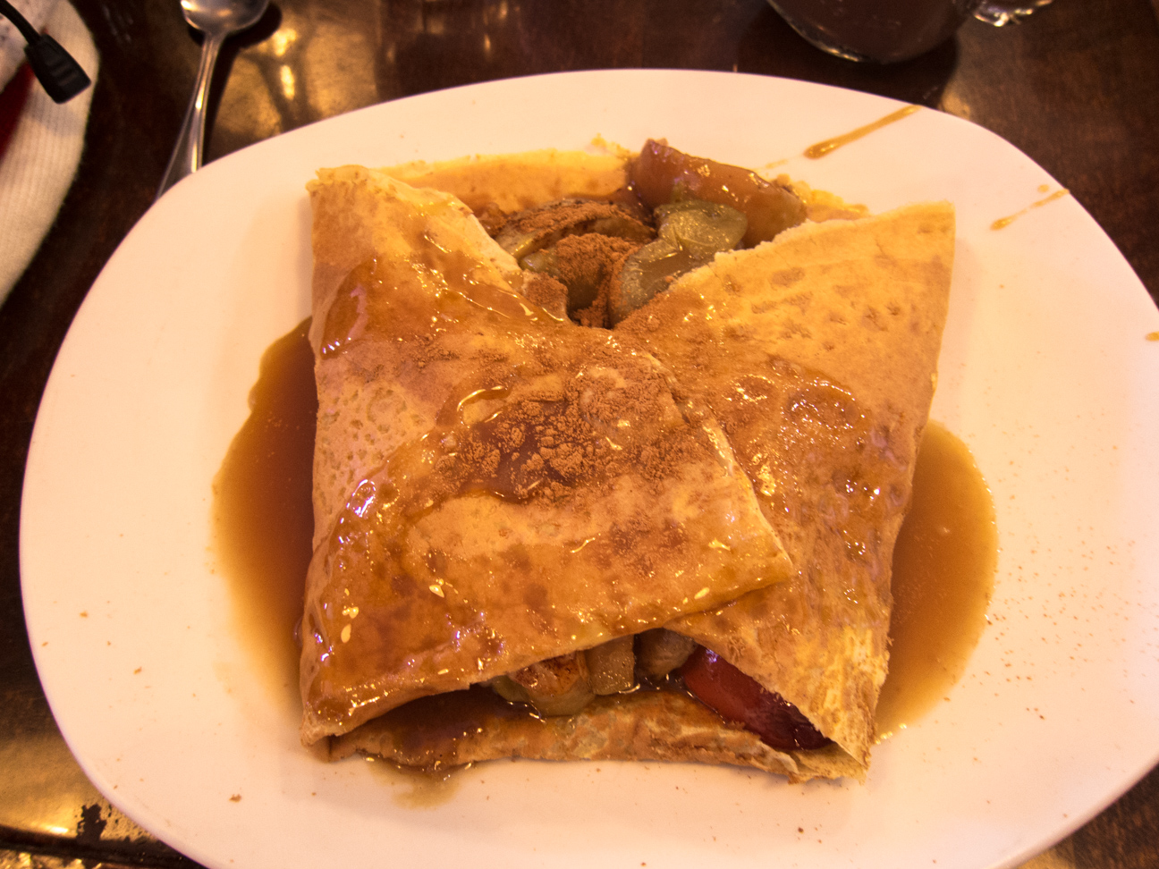 crepe filled with poached apples and cinnamon with maple cream