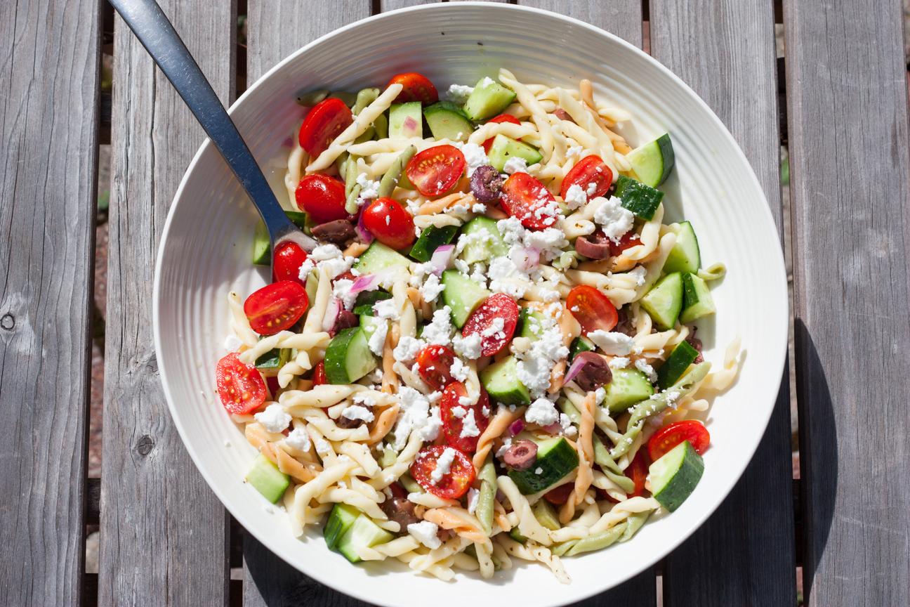 greek horiatiki pasta salad in a bowl