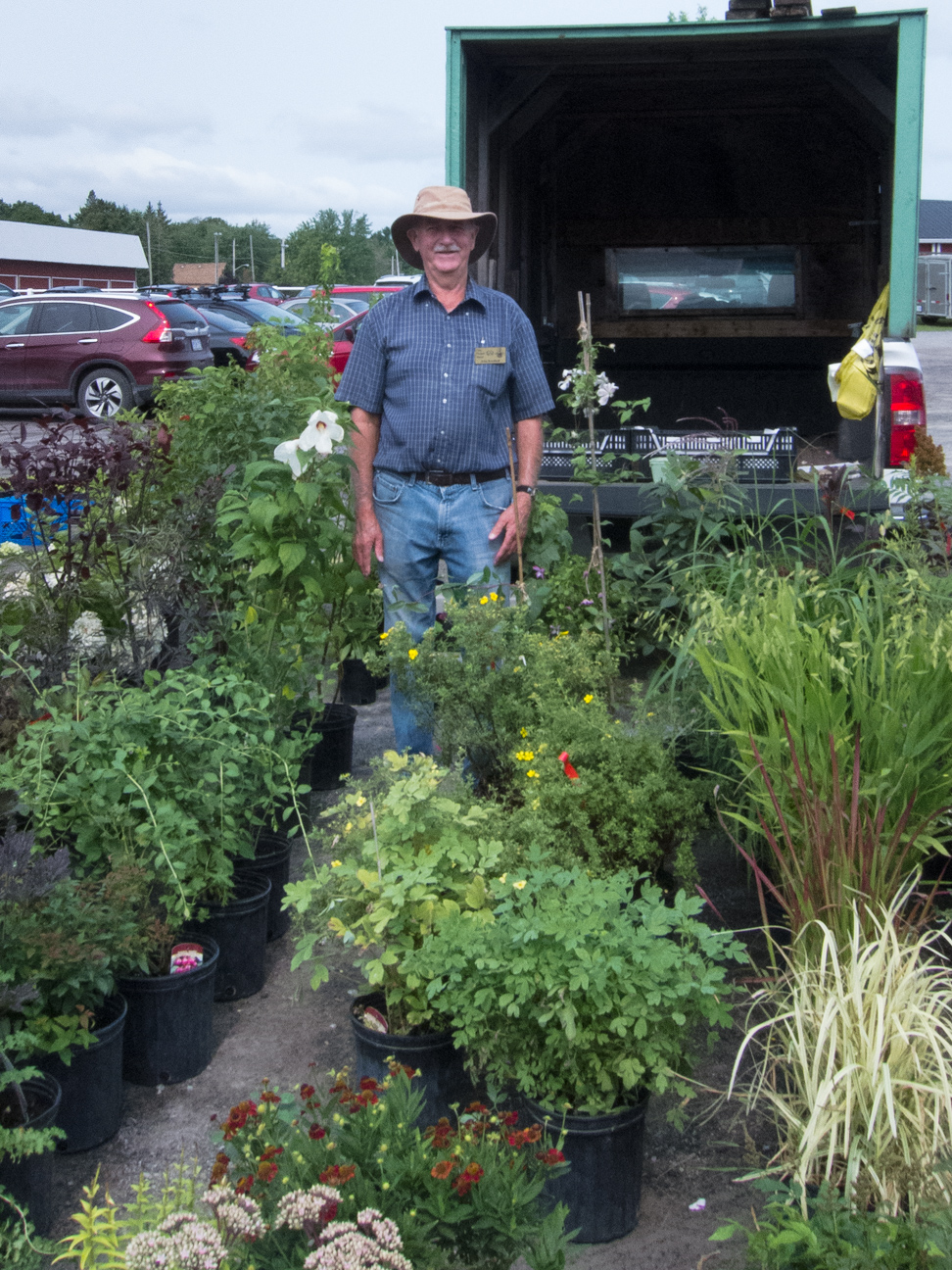 farmer standing with plants at Ottawa Farmer's Market