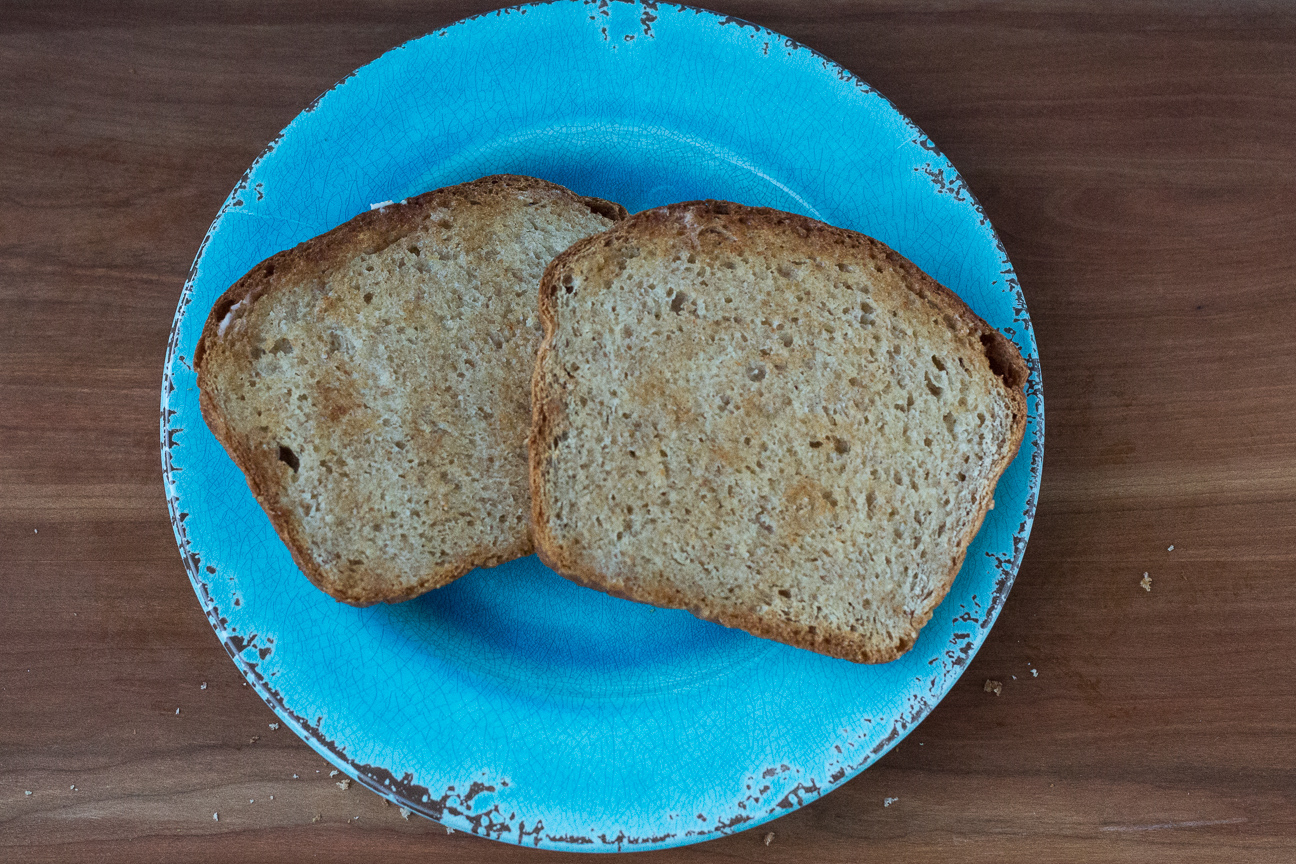 toasted Honey Butter Whole Wheat Bread on blue plate