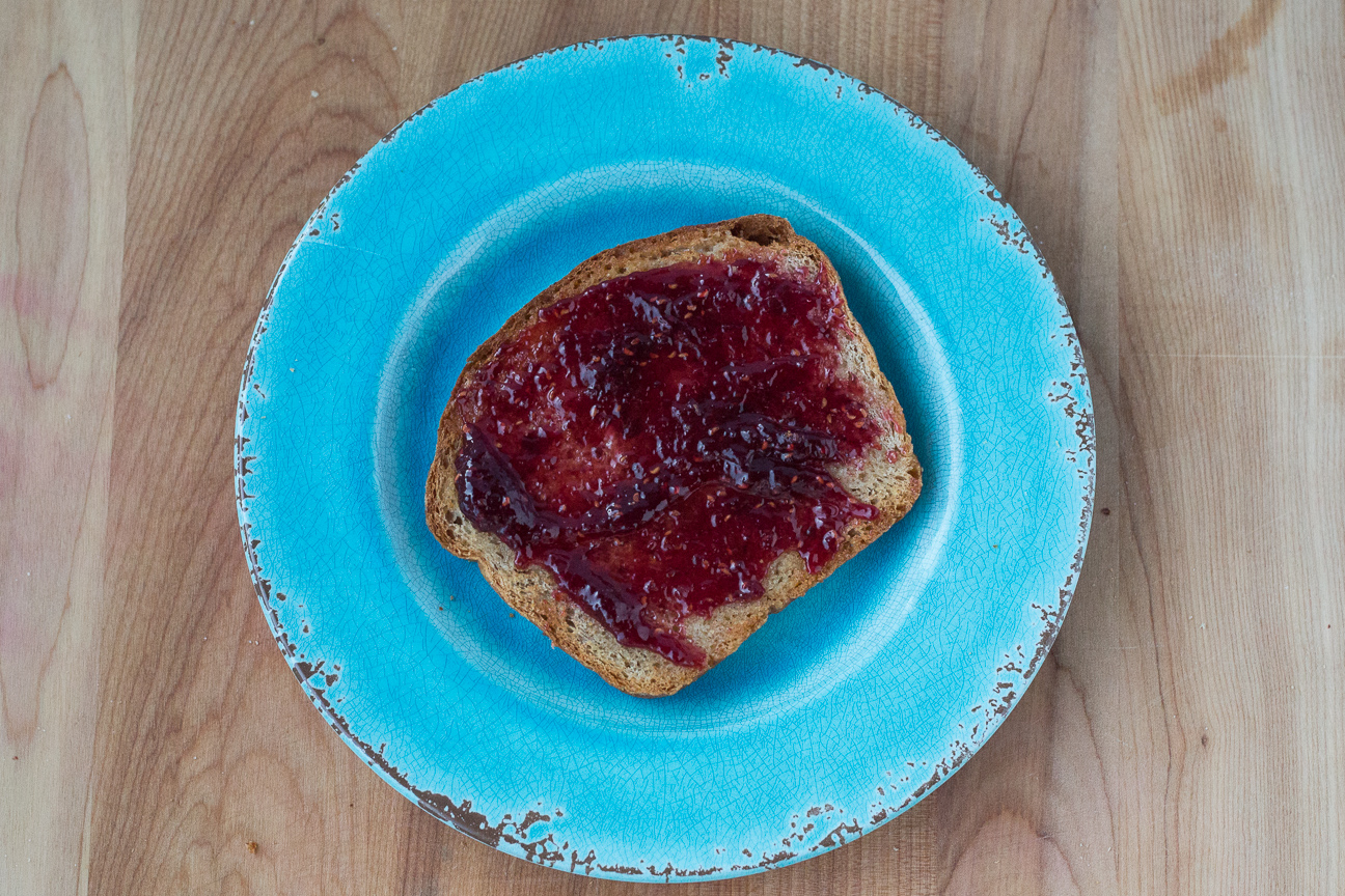 Honey Butter Whole Wheat Bread with jam on blue plate