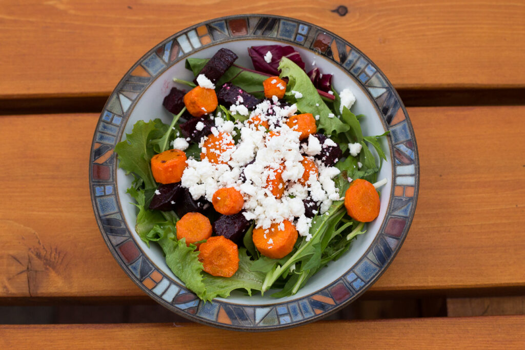 beet, carrot and feta salad in a bowl