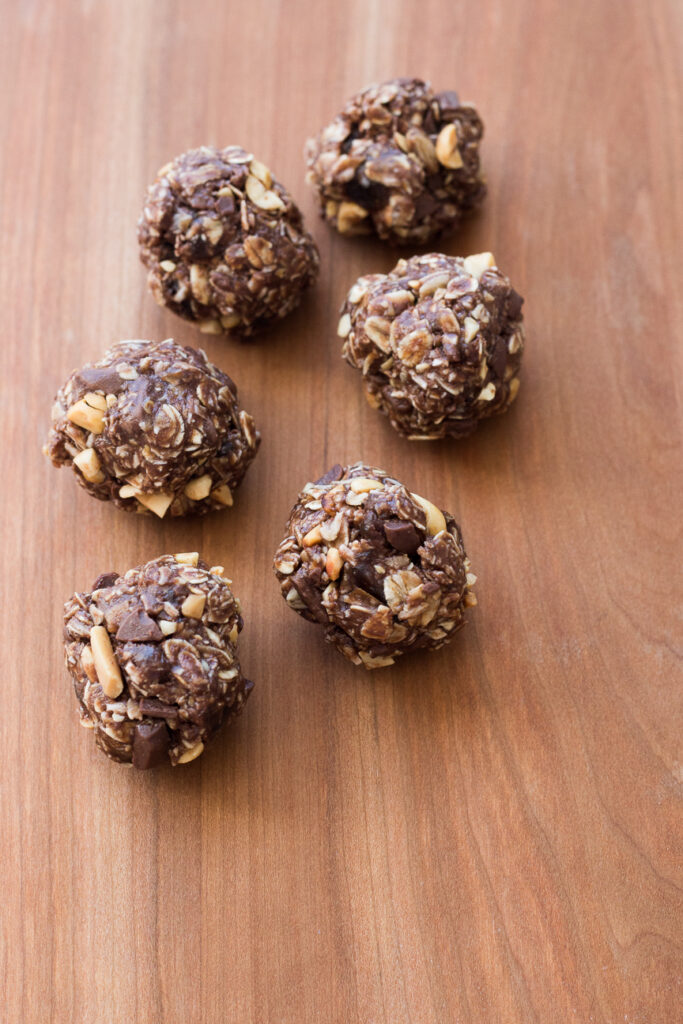 chocolate peanut butter energy balls on a wooden board