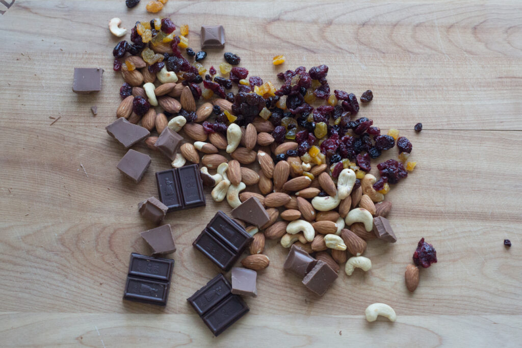 dried fruit and nuts on a cutting board
