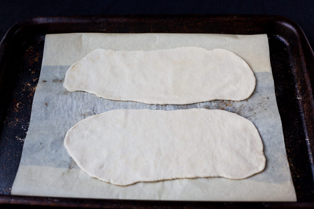 dough rolled out on a cookie tray